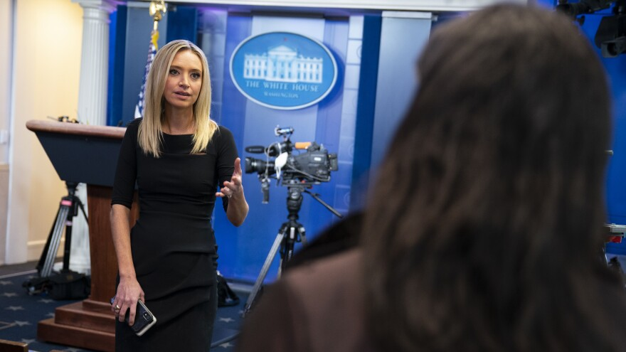 White House press secretary Kayleigh McEnany talks with reporters in the briefing room of the White House on April 30.