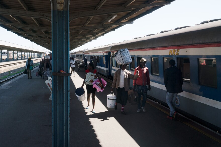 Passengers disembark from a train in Bulawayo, Zimbabwe.