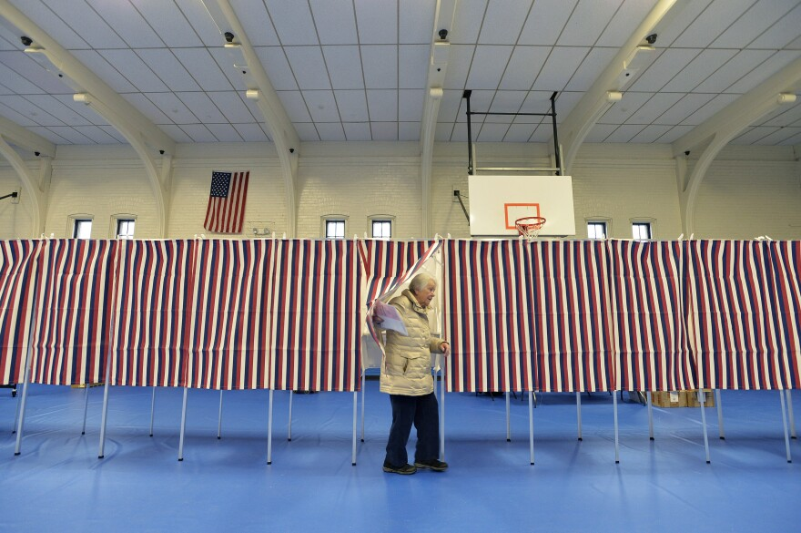 A voter leaves a polling booth at the Ward Five Community Center during the New Hampshire primary in Concord, N.H. on Tuesday. New Hampshire has served to reinforce or reset the Democratic primary race over the past five decades.