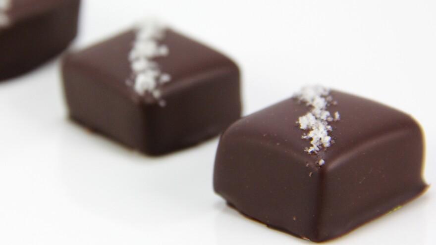 High-end salted caramel purveyor French Broad Chocolate Lounge grinds lavender buds with salt to top lavender-honey caramels.