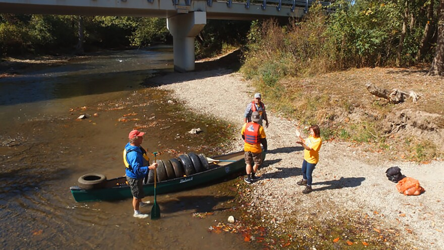 Volunteers pulling discarded tires from the Little Miami River.