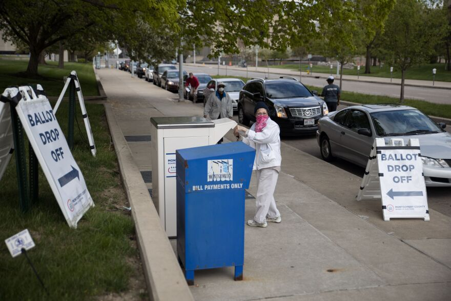 Ohio voters drop off their ballots last month in Dayton. The state's Republican secretary of state has gotten pushback from within his own party for wanting to expand absentee voting during the pandemic.