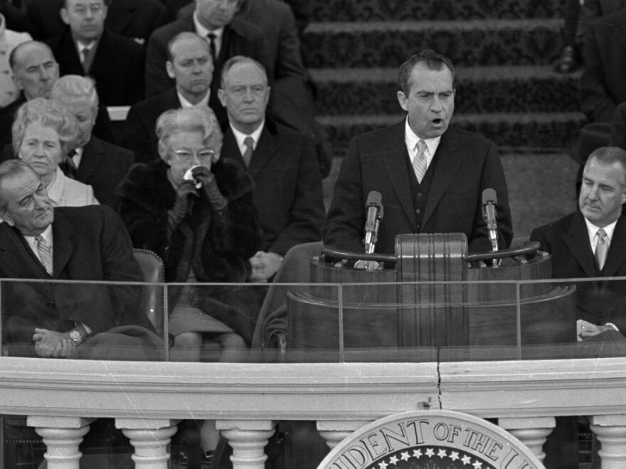 President Richard M. Nixon gives his inaugural address as former President Lyndon Johnson, right, listens on Jan. 20, 1969.