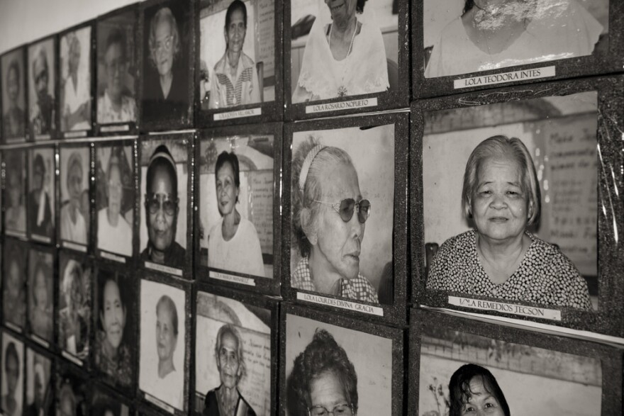 "Images of the estimated 1,000 Philippine ""comfort women"" who were enslaved and sexually victimized by the Japanese Imperial Army during World War II fill a wall at the offices of Lila Pilipina. The organization of World War II victims of sexual war crimes has helped the ""comfort women"" in their fight for compensation."
