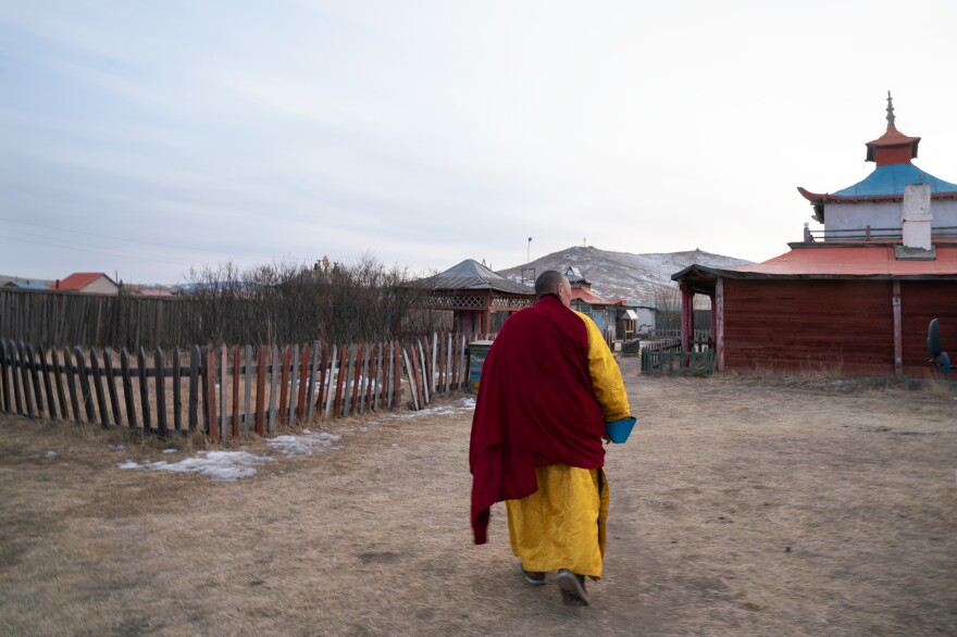Over half of Mongolia's population identifies as Buddhist. Herders in Arkhangai province who were affected by the 2009-2010 <em>dzud</em> sought spiritual counsel at a temple in the district of Tsenkher.