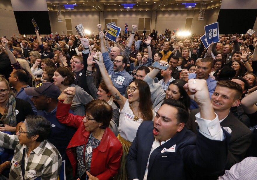 Supporters for Sharice Davids, a Democratic House candidate for Kansas, react as she is declared the winner during a watch party in Olathe, Kan., on Tuesday. Davids defeated incumbent Republican Rep. Kevin Yoder.