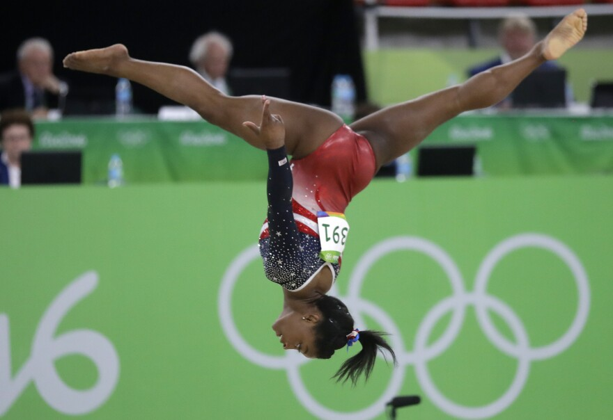 Simone Biles of the U.S. performs on the floor during the women's team final on Tuesday. Biles led the American squad to a runaway victory as the U.S. successfully defended the gold they won four years ago.