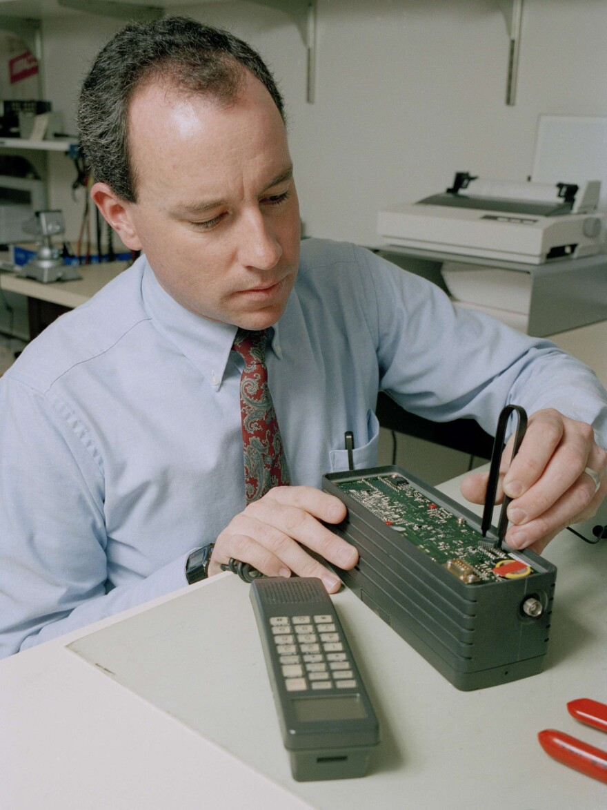 A phone number assignment is inserted into a cellular phone in California in January 1992.