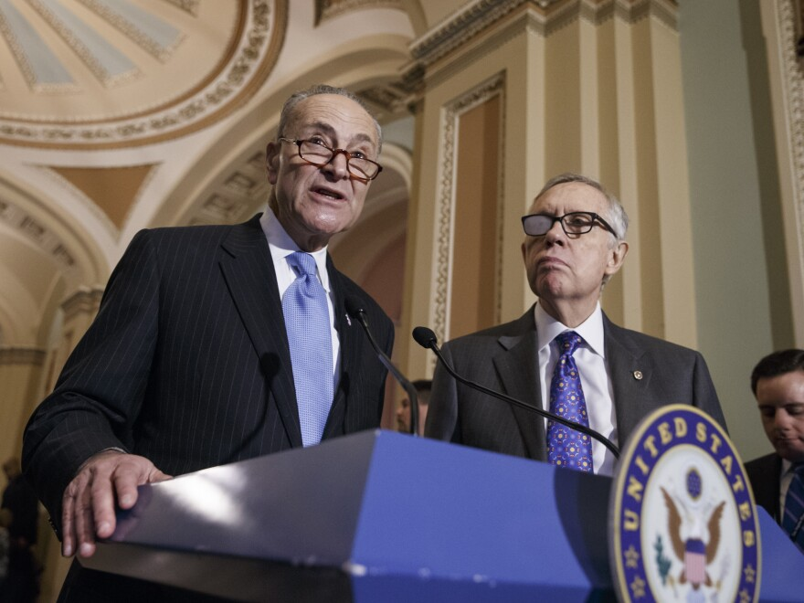 Sen. Charles Schumer of New York stands a podium March 3 as Senate Minority Leader Harry Reid of Nevada looks on. Reid is backing Schumer to be his replacement as Democratic leader.