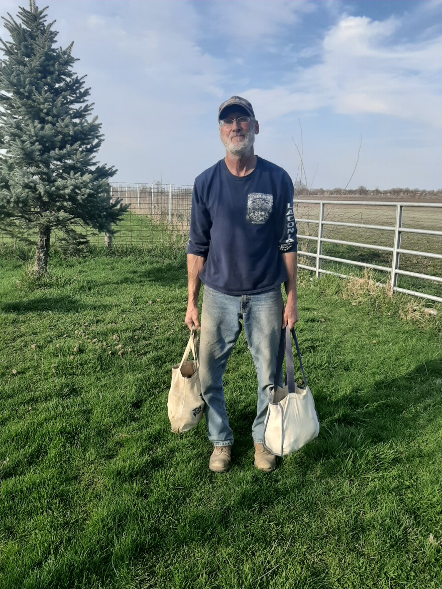 Clayton Wolf hauls his rocks in two canvas tote bags that sometimes end up weighing around 80 pounds.