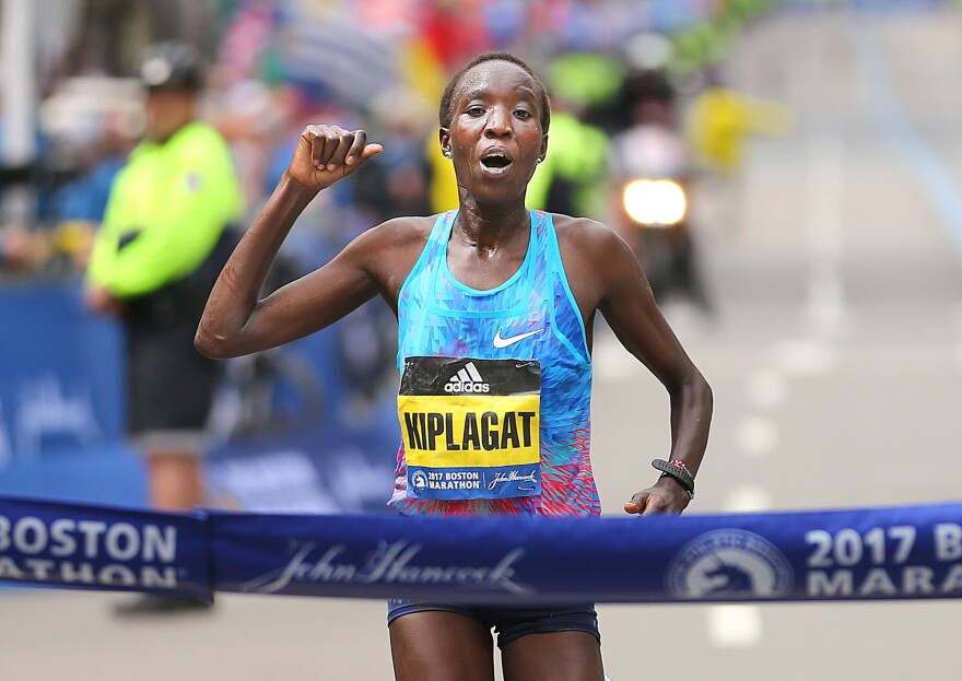 Edna Kiplagat crosses the finish line of the 121st Boston Marathon on April 17. It was her first time running the race.