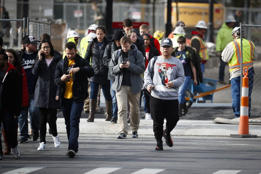 Students leave buildings as police respond to an attack Monday on campus at Ohio State University in Columbus, Ohio.