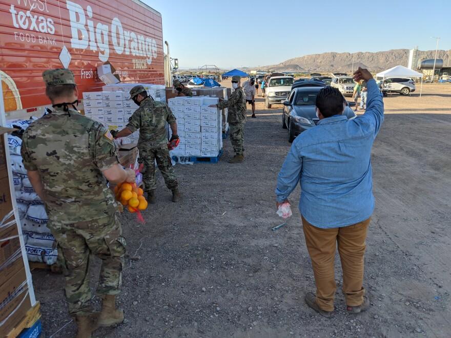 National Guardsmen assist West Texas Food Bank staffers.