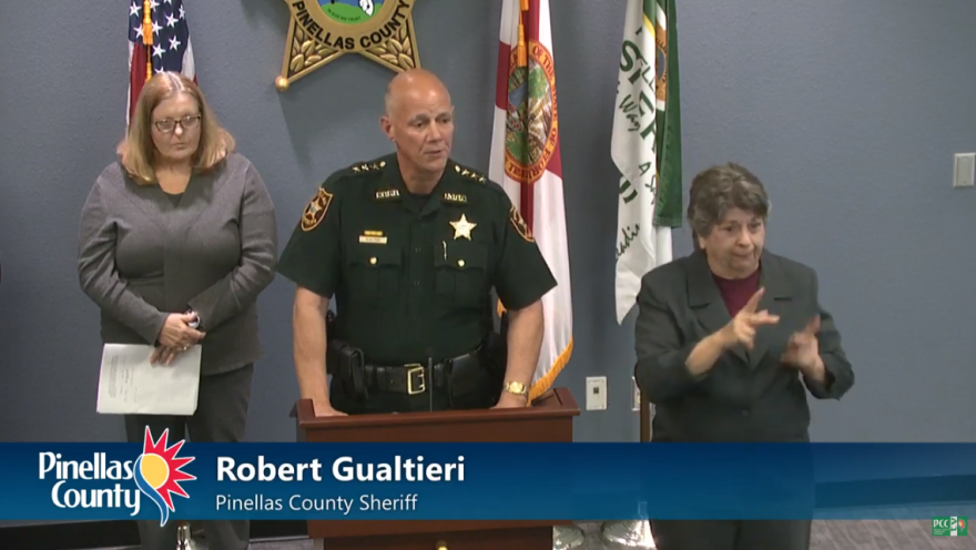 Sheriff Bob Gualtieri stands in front of a podium next to a sign language interpretor.