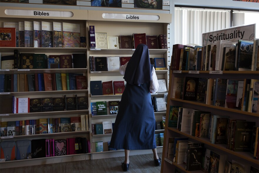 A Daughter of St. Paul works in the bookstore in Crestwood.