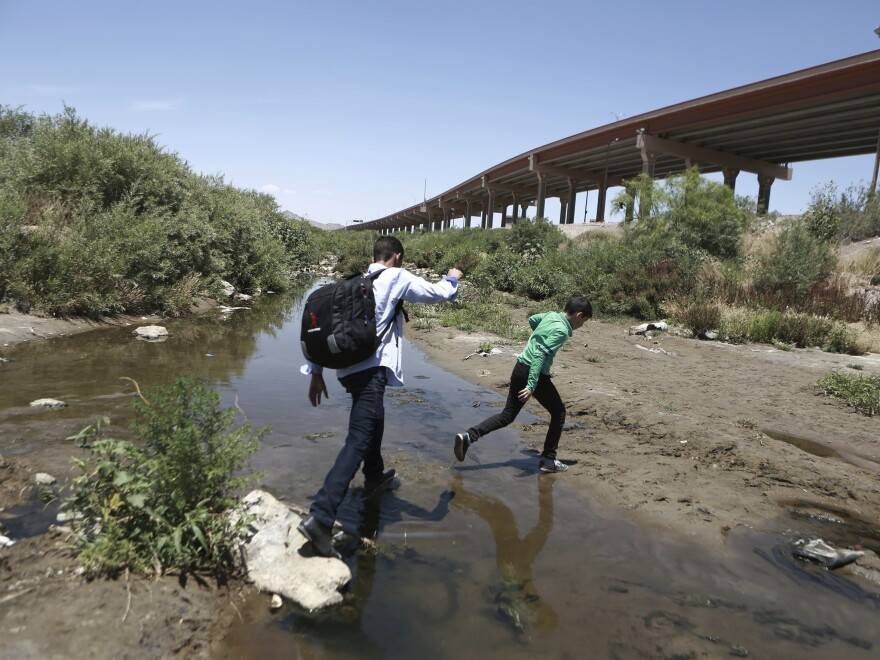 Migrants cross the Rio Grande into the United States, to turn themselves over to authorities and ask for asylum, in Ciudad, Juarez, in June.