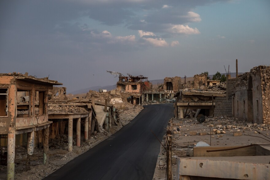 A newly paved road has been one of the only repairs done to the heavily damaged market area of the city of Sinjar, northern Iraq, after it was liberated by U.S.-backed Kurdish forces in 2015. Almost nothing has changed in the damaged old part of Sinjar since this photo was taken in 2019.