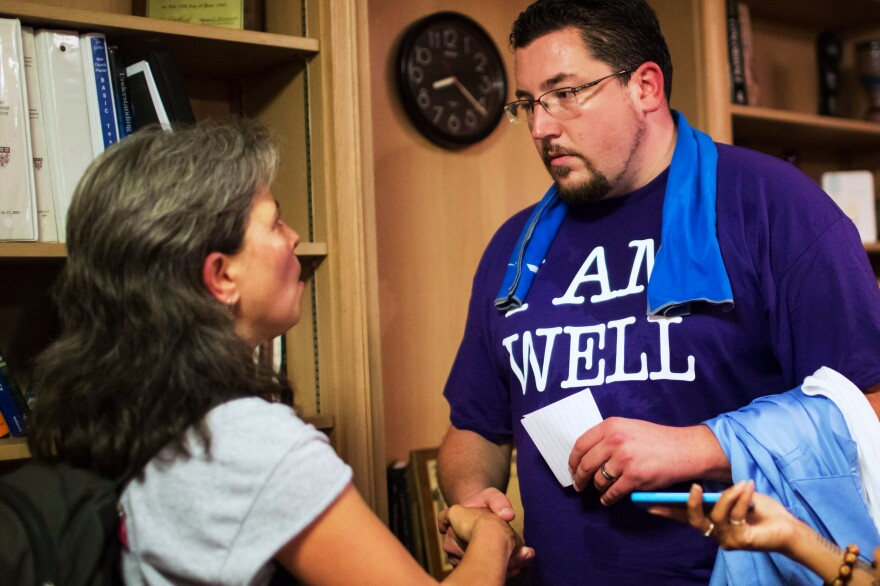 """Corinna Anjali (left) speaks to Mayor Knowles after the event. """"You're in the hot spot as the one person in power,"""" Anjali said to Knowles. """"It's important for you to say 'I hear you' to the people who have been hurt."""""""