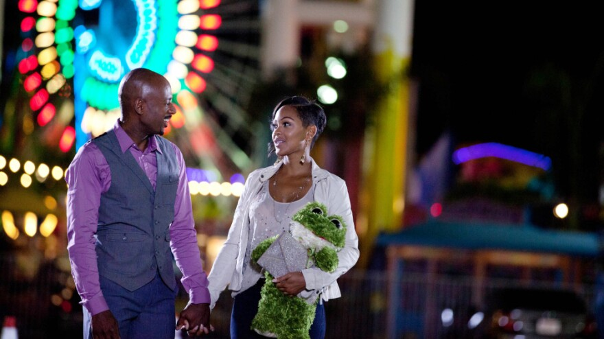 Mya (Meagan Good), while dating Zeke (Romany Malco), follows the do's and don't's of dating advice from comedian Steve Harvey's real-world self-help book <em>Act Like a Lady, Think Like a Man</em>.