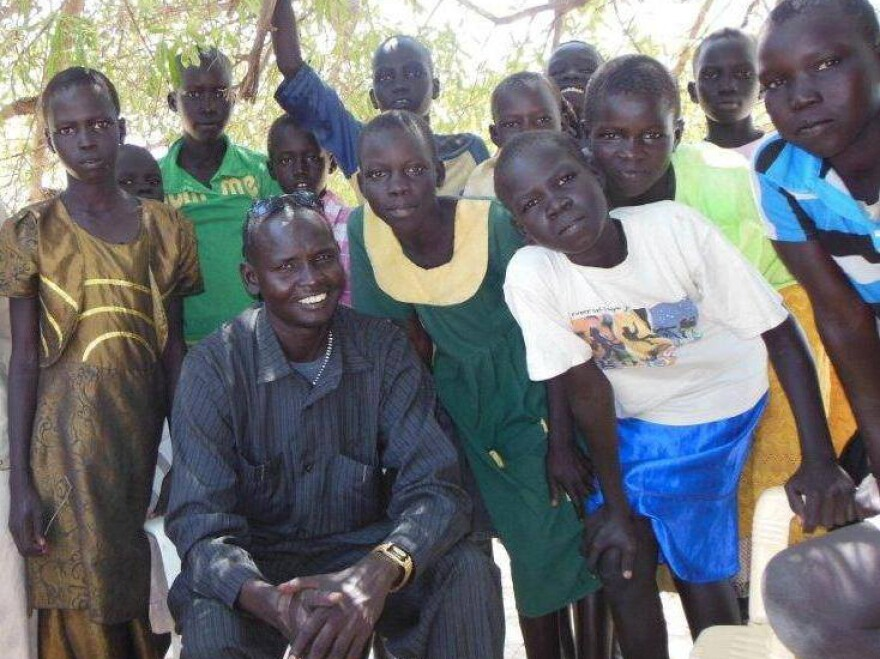 Daniel Majook Gai from South Sudan goes in and out of his war-torn country to help children there go to school.