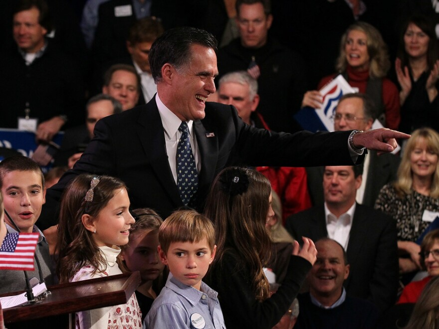 Mitt Romney greets supporters in Manchester, N.H., after his primary night win.