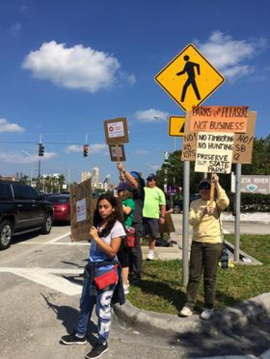 A recent protest opposing commercial interests in state parks - held outside the entrance of Oleta River State Park in North Miami Beach.
