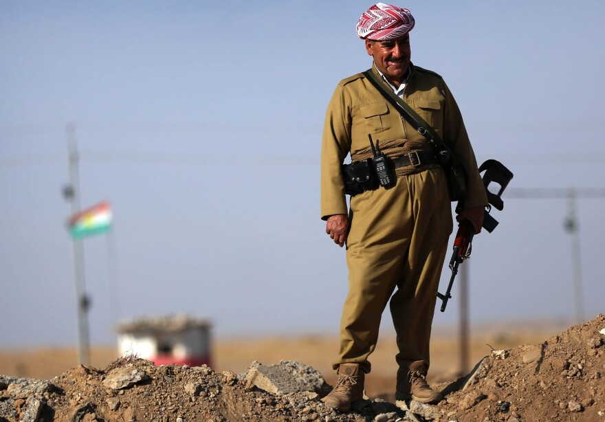 An Iraqi Kurdish peshmerga fighter stands on a berm 25 miles south of Irbil, the capital of the Kurdish region in northern Iraq, on Oct. 5. Turkish Kurds have been joining the Iraqi Kurds in the fight against the Islamic State.