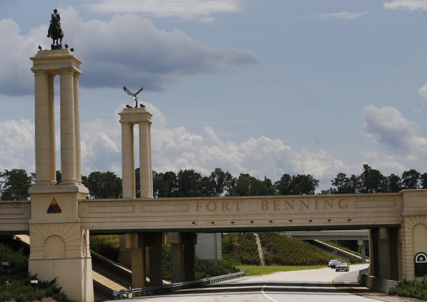 A bridge over I 185 marks the entrance to the U.S. Army's Fort Benning in Columbus, Ga. It is one of the 10 Army bases name after a Confederate official and Congress is considering a bill to change those names.