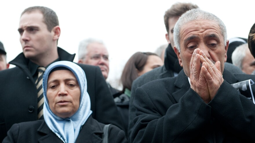Ismail Yozgat (right) and Ayse Yozgat pray at a memorial event on the seventh anniversary of the murder of their son Halit in Kassel, Germany.