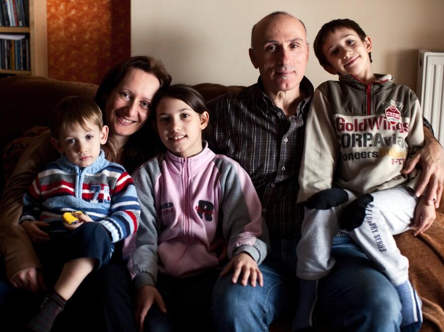 Alexandra Tsitoura and Nikos Aivatzidis with their three children, Marios, 2, (left), Fani, 9, and Dimitris, 6, in their home in Athens.