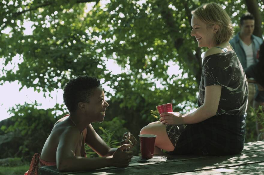 "Moira (Samira Wiley, left) and Offred (Elisabeth Moss) are best friends ""before Gilead."" In flashbacks, their world seems normal — they go for jogs, talk about Uber and Tinder, and organize protests."