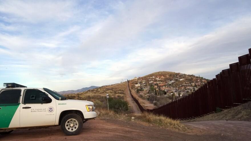U.S. Border Patrol next to the the border wall dividing Nogales, Ariz., and Nogales Mexico.