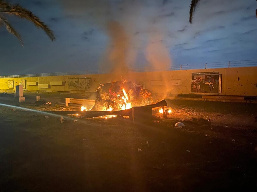 A vehicle hit by a missile burns outside the Baghdad International Airport, where U.S. airstrikes killed Qassem Soleimani, the head of Iran's elite Quds Force, at the direction of President Trump.