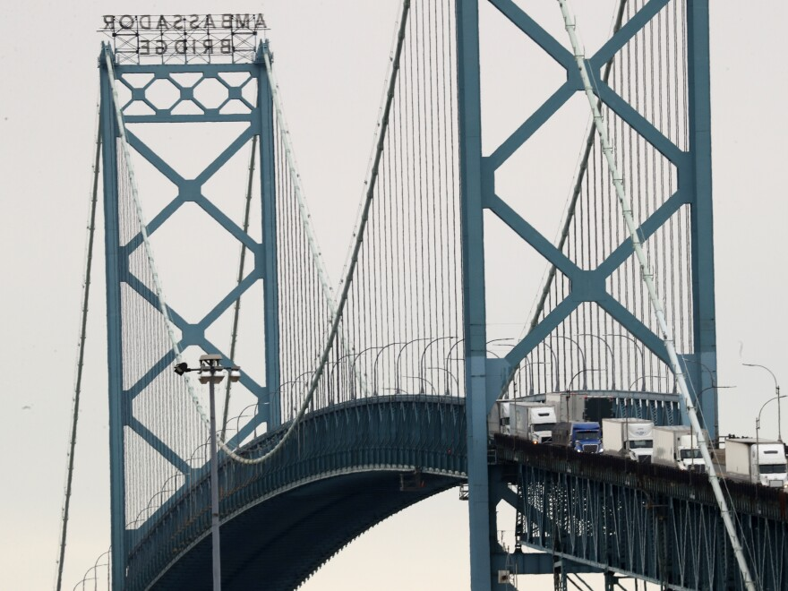 Vehicles move across the Ambassador Bridge between Detroit and Windsor, Ontario, as seen from Detroit on Monday. President Trump ordered the border with Canada partly closed on Wednesday.