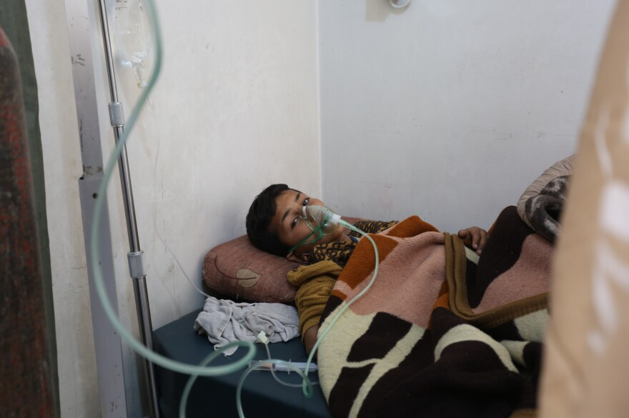 A 9-year-old survivor of a chemical attack on a rebel-held region of Syria on Tuesday receives medical treatment at a hospital in Idlib, Syria, on Wednesday.