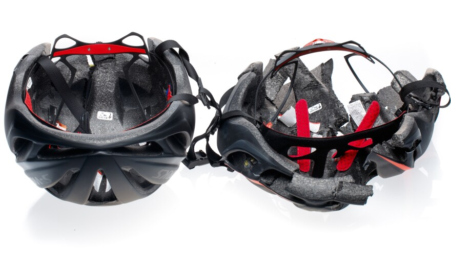 After impact, the authentic Specialized Evade helmet on the left held up but the counterfeit on the right crumbled. Specialized says the fakes lack reinforced roll cages — internal skeletons that hold the helmets together even after a crash.