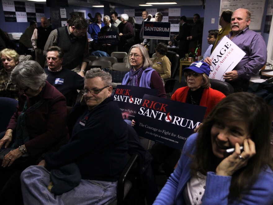 Santorum supporters watch the vote count during an Iowa caucus watch party in New Hampshire on Tuesday night.