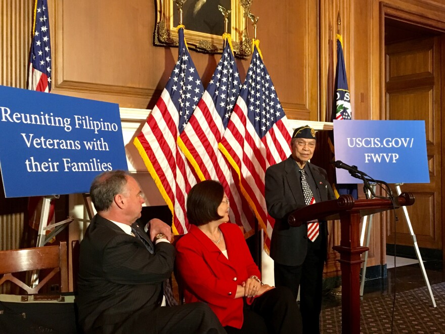 Rudolpho Panaglima (right) speaks on Capitol Hill in Washington, D.C.
