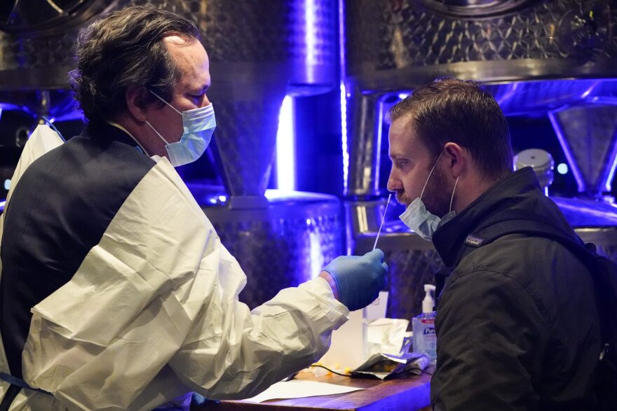 """A medical professional administers a COVID-19 test to enter City Winery Tuesday, Nov. 24, 2020, in New York. City Winery will be the first restaurant in the nation to create a """"100% COVID-tested space"""". The program will run every Tuesday and Wednesday evening for the remainder of 2020. (Frank Franklin II/AP)"""