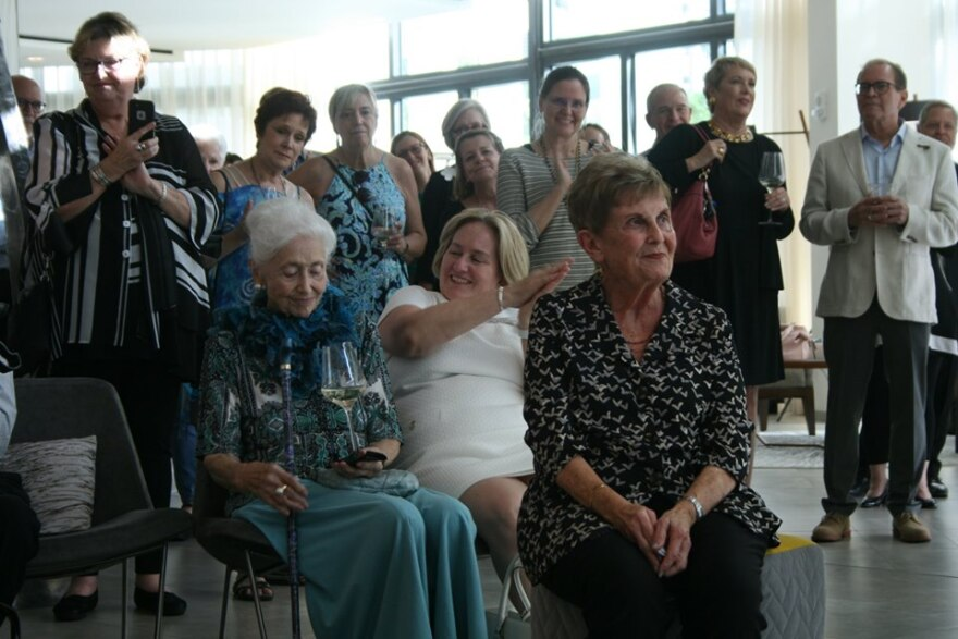 A gathering at a hotel lounge to celebrate arts advocate Nancy Roucher