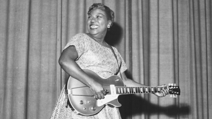 Sister Rosetta Tharpe onstage with her guitar in 1957.