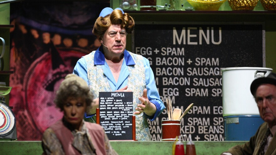 """Terry Jones performs the famous """"Spam"""" sketch during 2014's <em>Monty Python Live (Mostly)</em> stage show. Jones died at the age of 77 after suffering from dementia."""