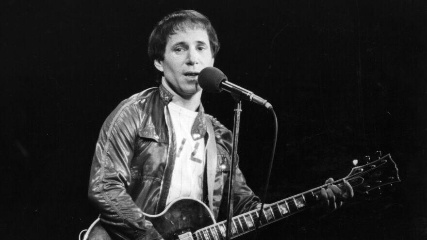 Paul Simon performing in London circa 1980.