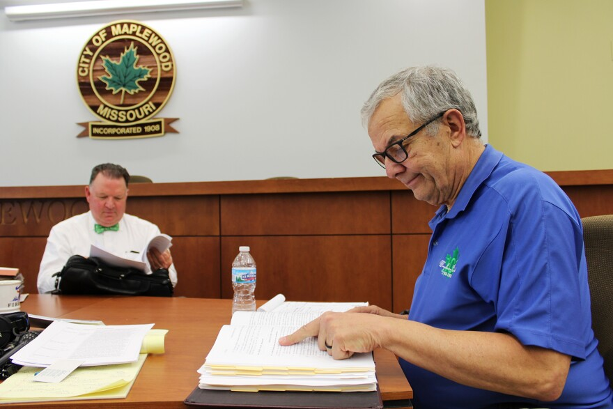 Maplewood city attorney Craig Biesterfeld and City Manager Marty Corcoran look through the city code during a meeting with a reporter at Maplewood City Hall.