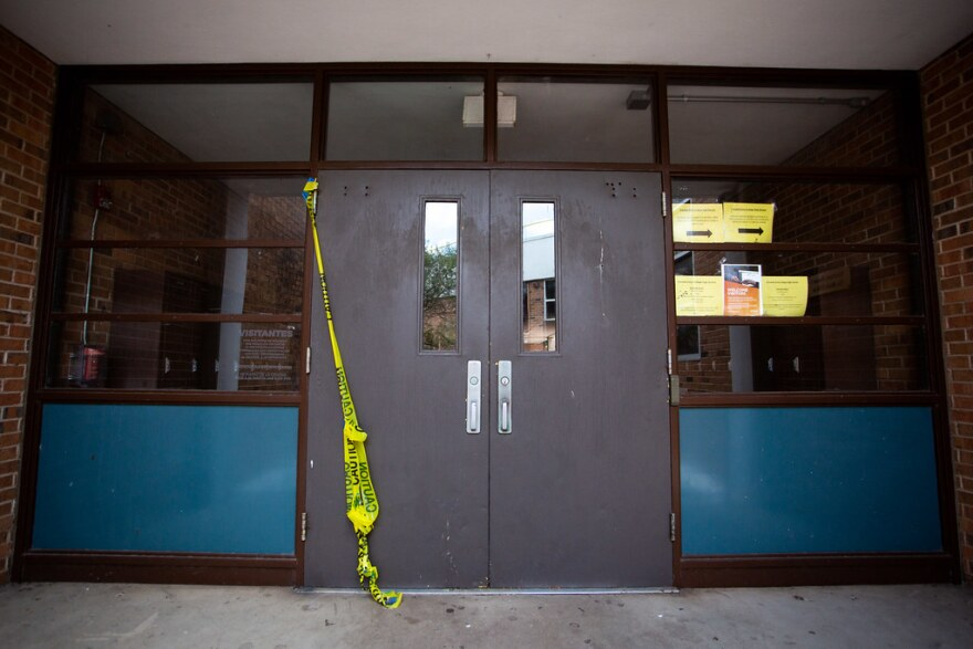 Caution tape hangs from the door of Crockett High School in South Austin last month.