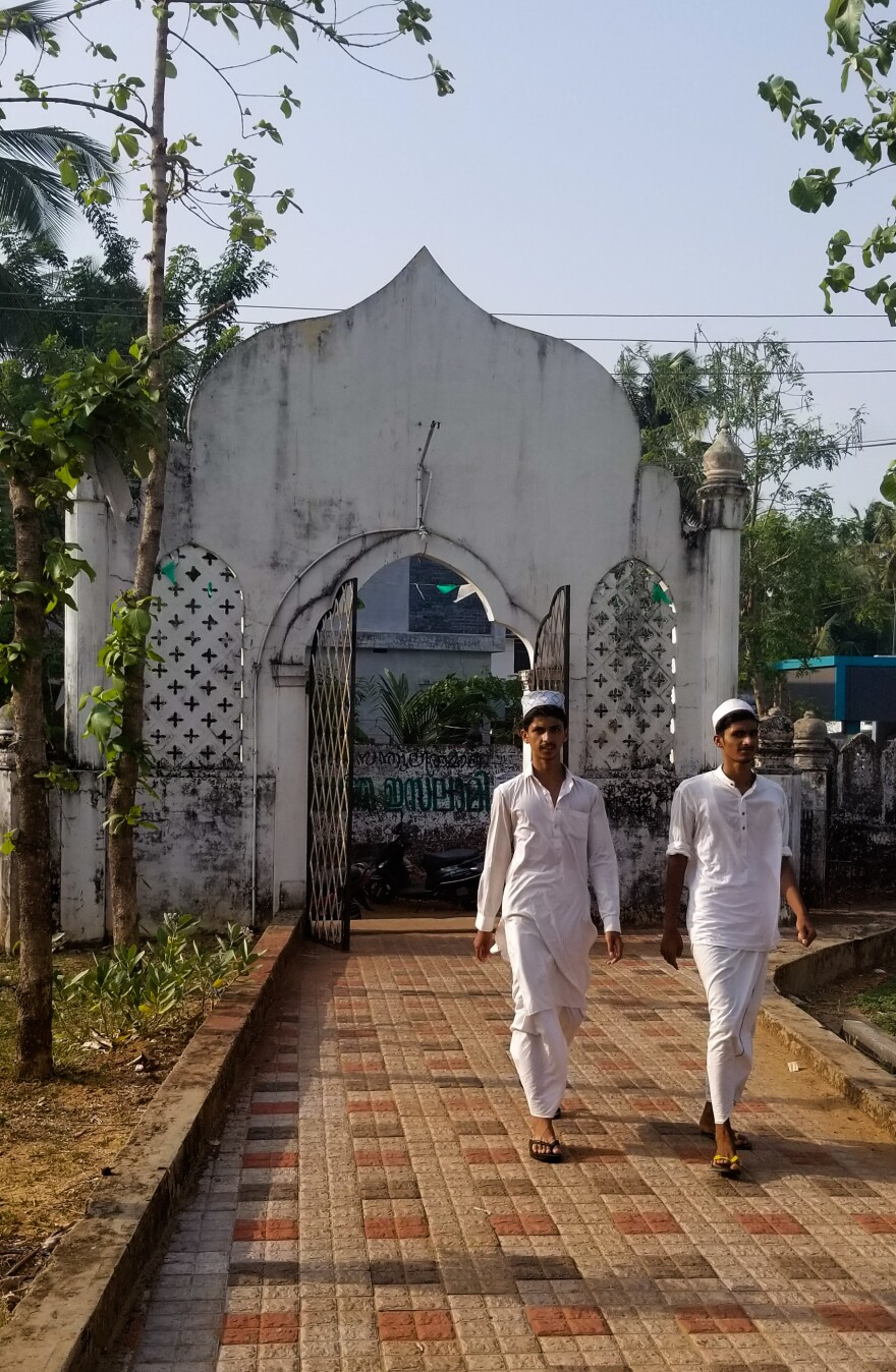 Students enter an Islamic school attached to a 400-year-old mosque in Padanna, a village on India's southwest coast.