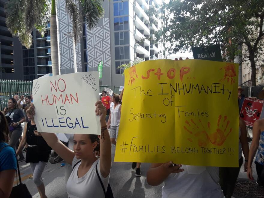 An anti-ICE protest in downtown Miami in June, 2018. Protesters voiced anger at federal immigration policies, but also at local officials who they see as working in collaboration with ICE.