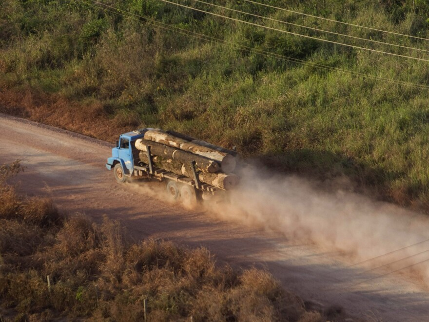 """A truck carrying hardwood timber drives along a rural road leading to Paragominas, Brazil, on Sept. 23, 2011. The city has become a pioneering """"Green City,"""" a model of sustainability with a new economic approach that has seen illegal deforestation virtually halted."""