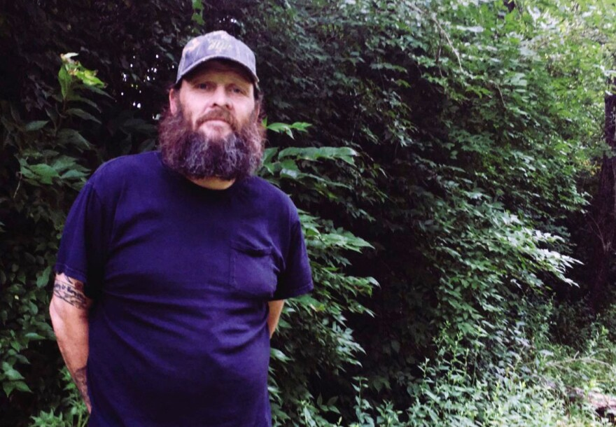 "Charles ""Country"" Bowers revisits the wooded patches where he once lived."