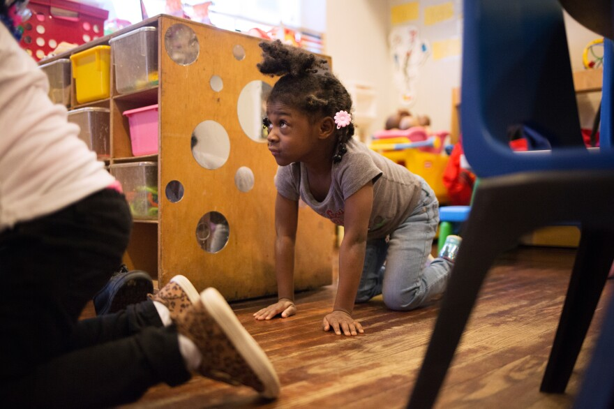 "Justice Buress, 4, demonstrates how she drops to the floor when she hears her teacher call out ""Dora the Explorer"" during monthly drills at Little Explorers Learning Center."
